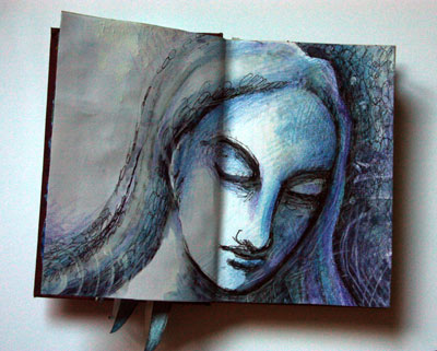 Altered book with woman's face