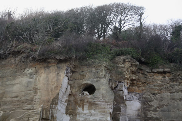Cave in cliff - Pett Level beach