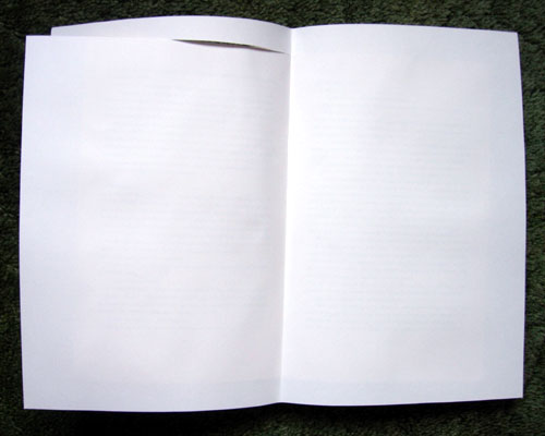 Opened book with Paper